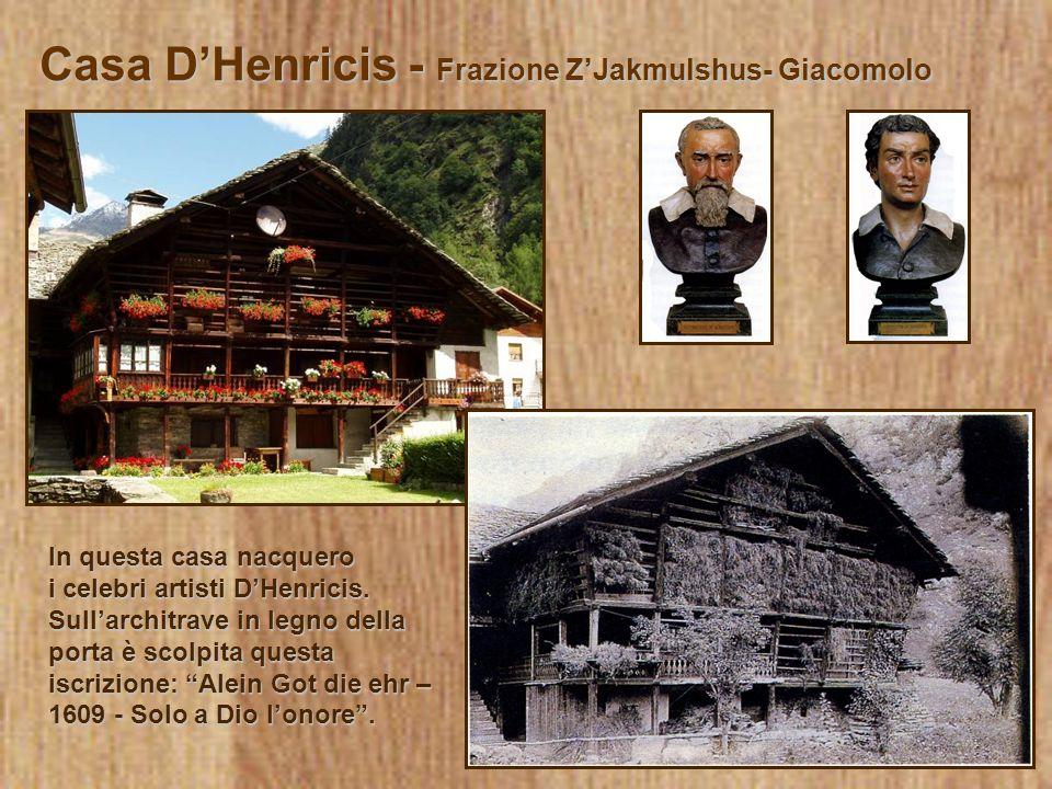 Casa DHenricis - Frazione ZJakmulshus- Giacomolo In questa casa nacquero i celebri artisti DHenricis. Sullarchitrave in legno della porta è scolpita q
