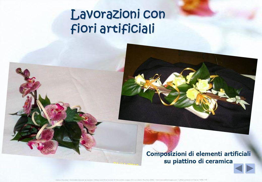 Lavorazioni con fiori artificiali Composizioni di elementi artificiali su piattino di ceramica