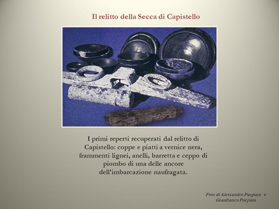 I primi reperti recuperati dal relitto di Capistello: coppe e piatti a vernice nera, frammenti lignei, anelli, barretta e ceppo di piombo di una delle
