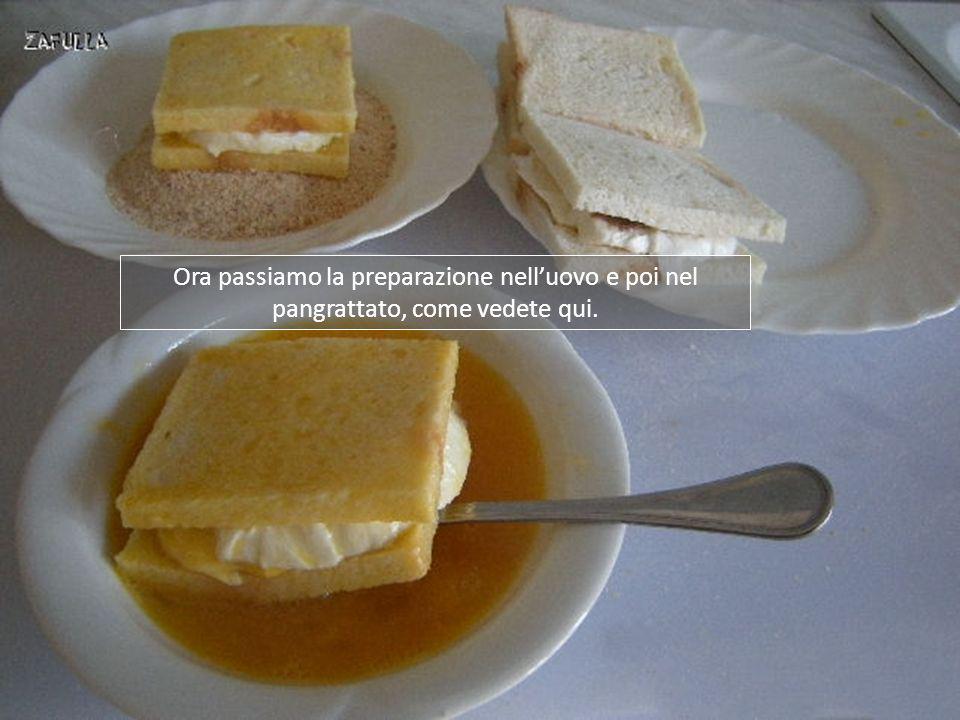 Ora, tenendoli in verticale, bagniamo i bordi del pane, per tutti e quattro i lati: questo permetterà di racchiudere bene il ripieno.