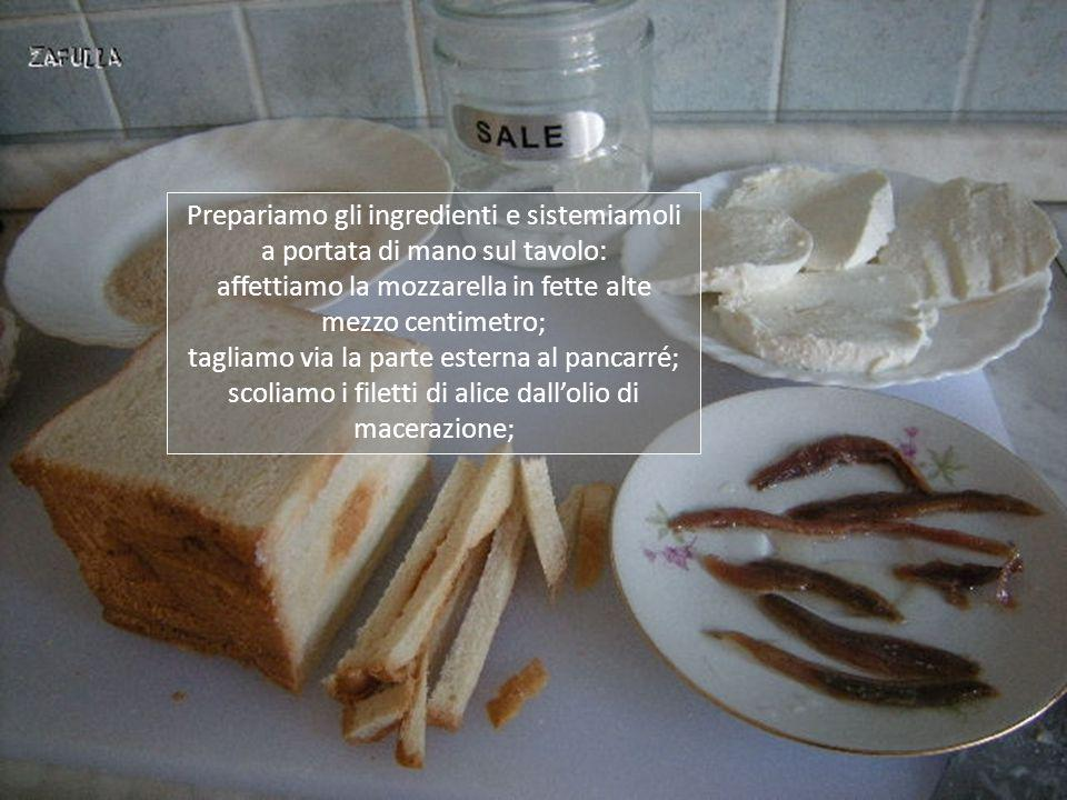 Ingredienti x 4 persone: 8 fette di pancarré 200 grammi di mozzarella o fior di latte alici diliscate sottolio 2 uova pangrattato 1 bicchiere di latte