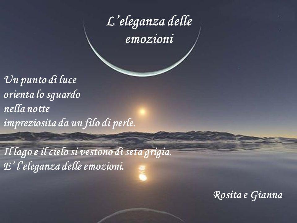 Leleganza delle emozioni Un punto di luce orienta lo sguardo nella notte impreziosita da un filo di perle. Il lago e il cielo si vestono di seta grigi