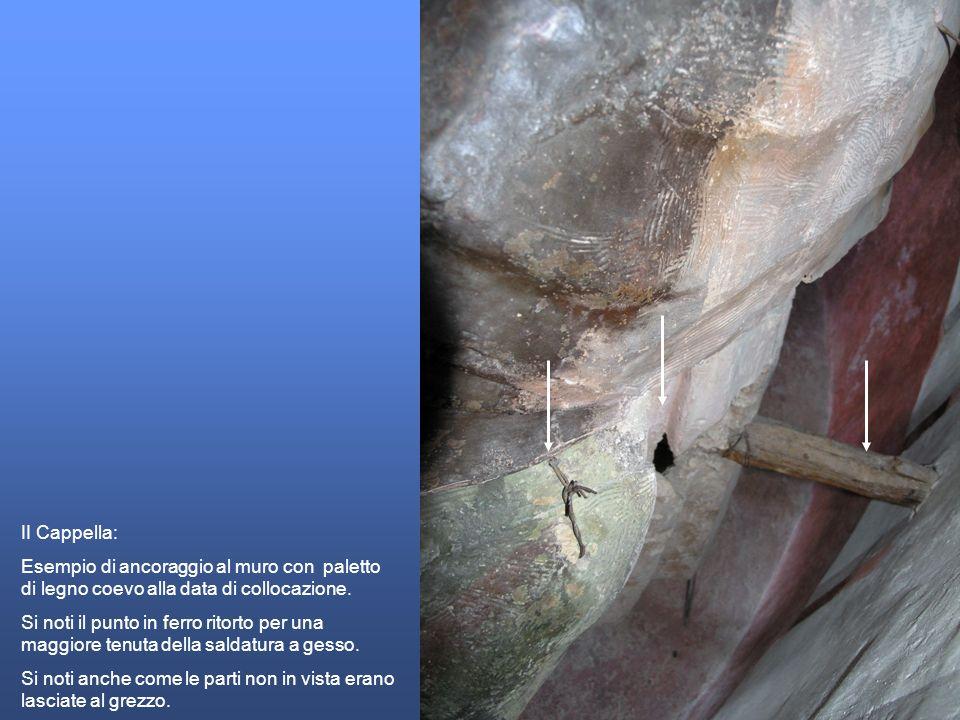 II Cappella: Esempio di ancoraggio al muro con paletto di legno coevo alla data di collocazione. Si noti il punto in ferro ritorto per una maggiore te
