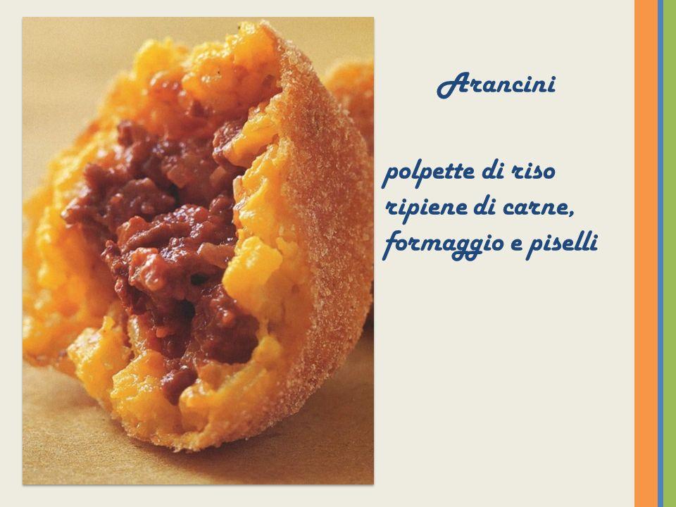 Sfinci di San Giuseppe Frittelle farcite con crema di ricotta, decorate con granella di pistacchi e frutta candita.