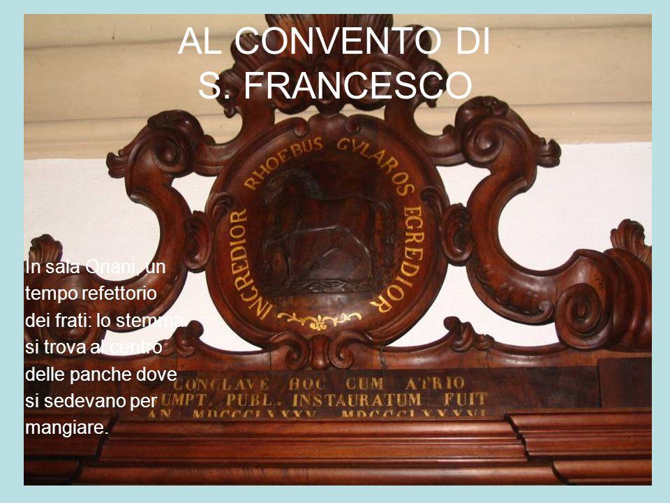 AL CONVENTO DI S. FRANCESCO In sala Oriani, un tempo refettorio dei frati: lo stemma si trova al centro delle panche dove si sedevano per mangiare.
