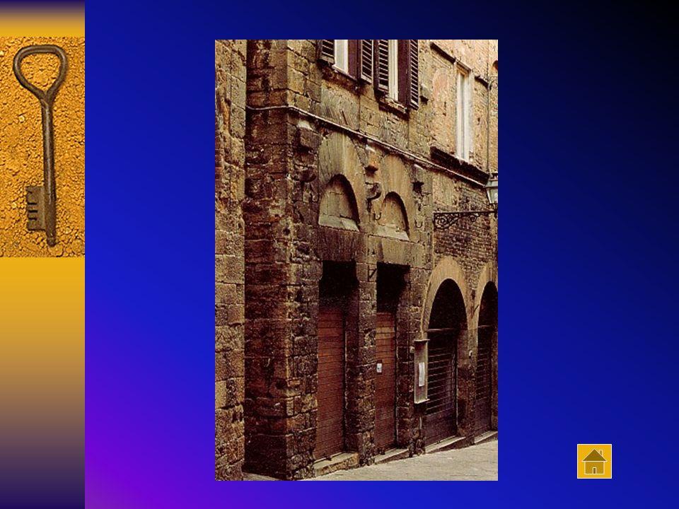 Casa Miranceli (XIV sec.). La facciata presenta un aspetto alquanto inconsueto, dato che l'uso del cotto è piuttosto raro, negli edifici volterrani, p