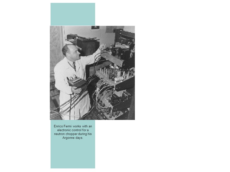 Enrico Fermi works with an electronic control for a neutron chopper during his Argonne days.