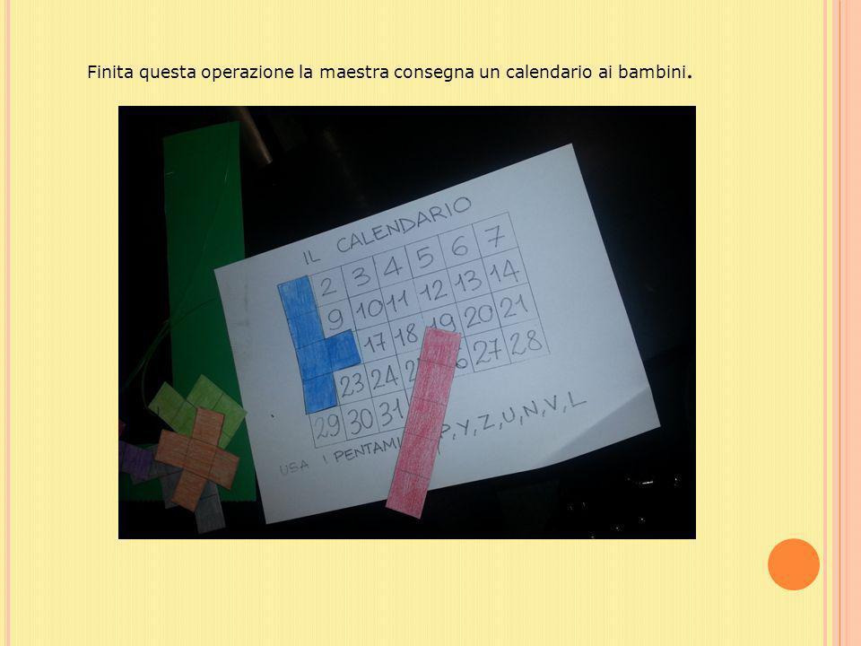 Finita questa operazione la maestra consegna un calendario ai bambini.
