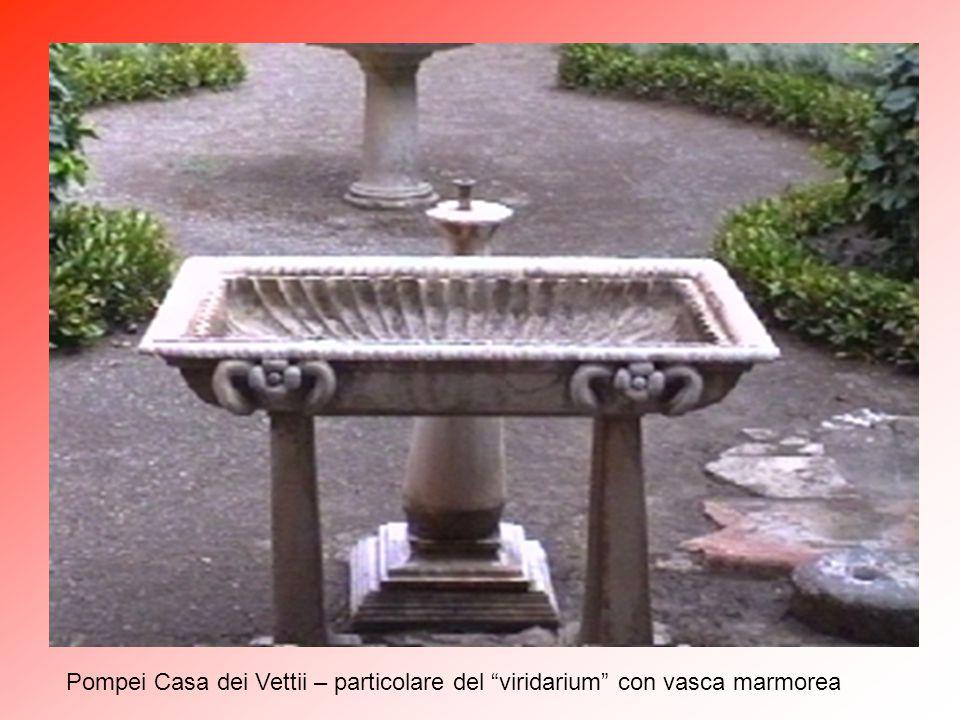 "Pompei Casa dei Vettii – particolare del ""viridarium"" con amorino bronzeo"