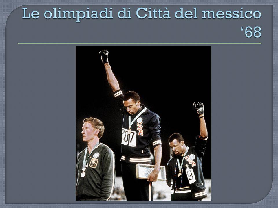  Tommie Smith e John Carlos, oro e bronzo nei 200 metri, alzano il pugno guantato a sostegno del movimento per i diritti civili: la squadra USA li sospenderà