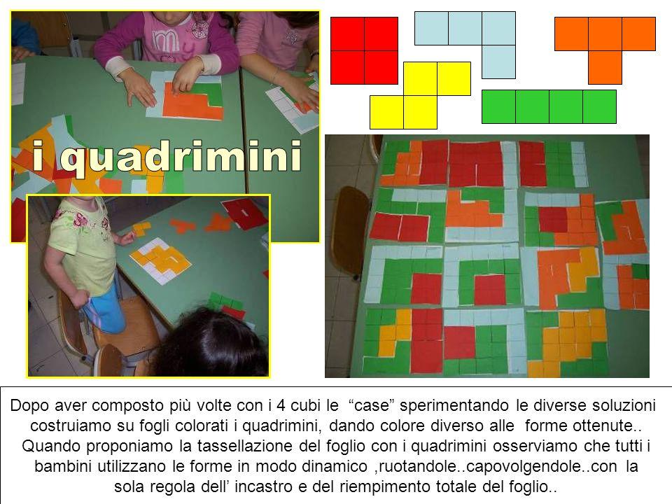 """Dopo aver composto più volte con i 4 cubi le """"case"""" sperimentando le diverse soluzioni costruiamo su fogli colorati i quadrimini, dando colore diverso"""