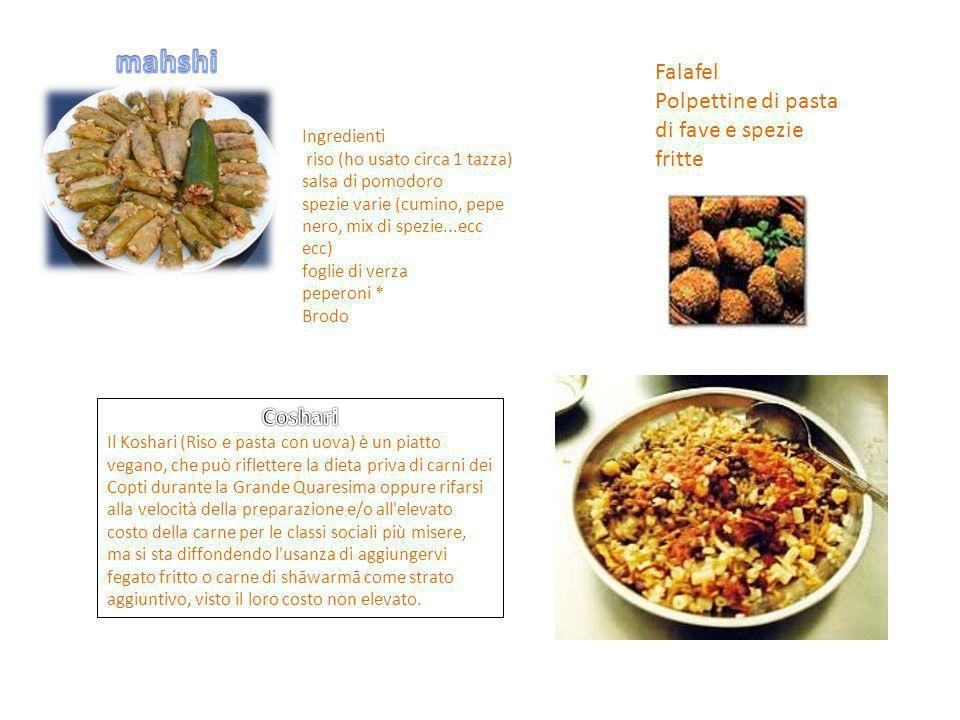 Ingredienti riso (ho usato circa 1 tazza) salsa di pomodoro spezie varie (cumino, pepe nero, mix di spezie...ecc ecc) foglie di verza peperoni * Brodo