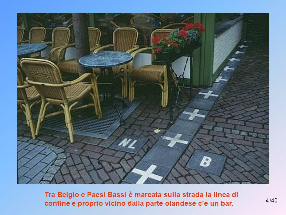 4 /40 Tra Belgio e Paesi Bassi è marcata sulla strada la linea di confine e proprio vicino dalla parte olandese c'e un bar.