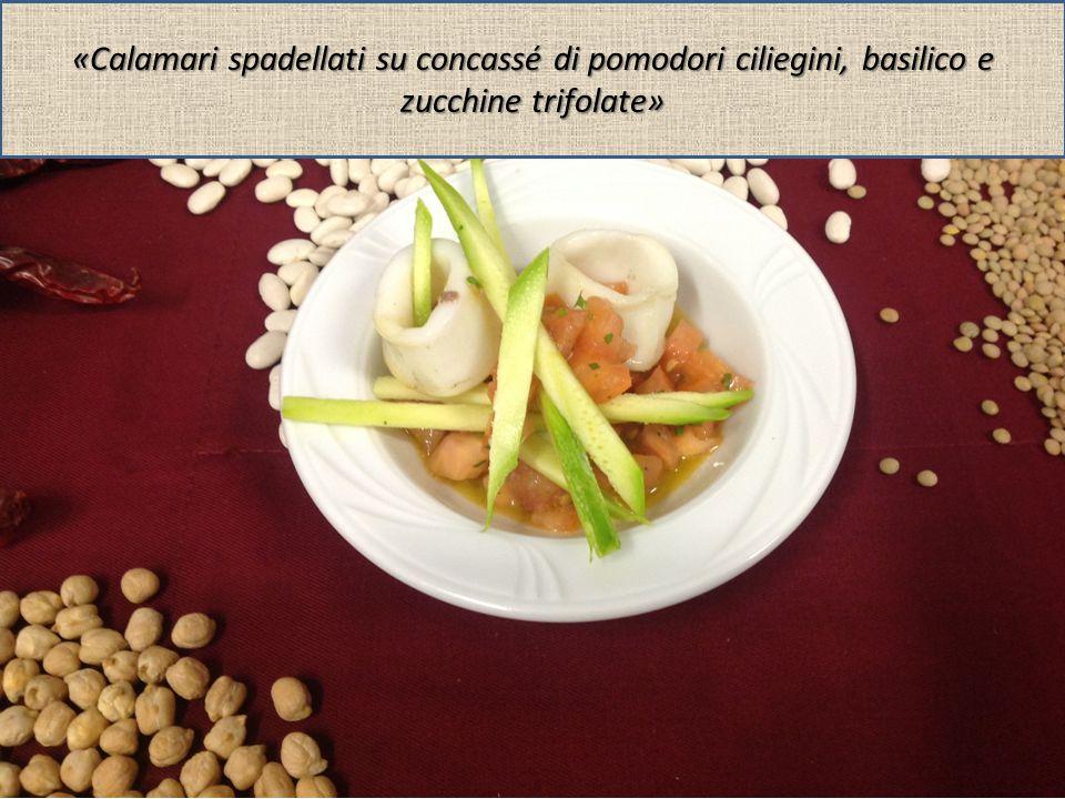 «Calamari spadellati su concassé di pomodori ciliegini, basilico e zucchine trifolate»